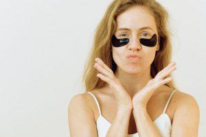 woman with eye cream under her eye