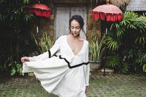 Woman in white tunic dress