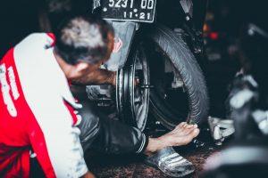 Mechanic using a portable truck tire changer