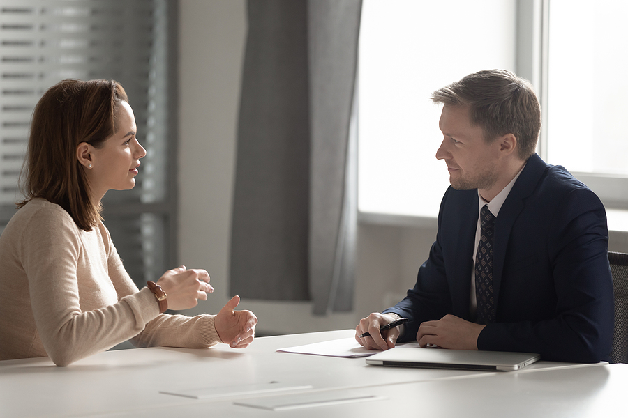 Liverpool lawyer talking to a client