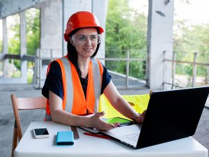 Female manager using a construction ERP software in her laptop