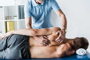 Norwest Chiropractor massaging a man's back