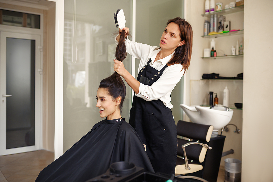 Beautician in Sydney CBD blow drying a woman's hair