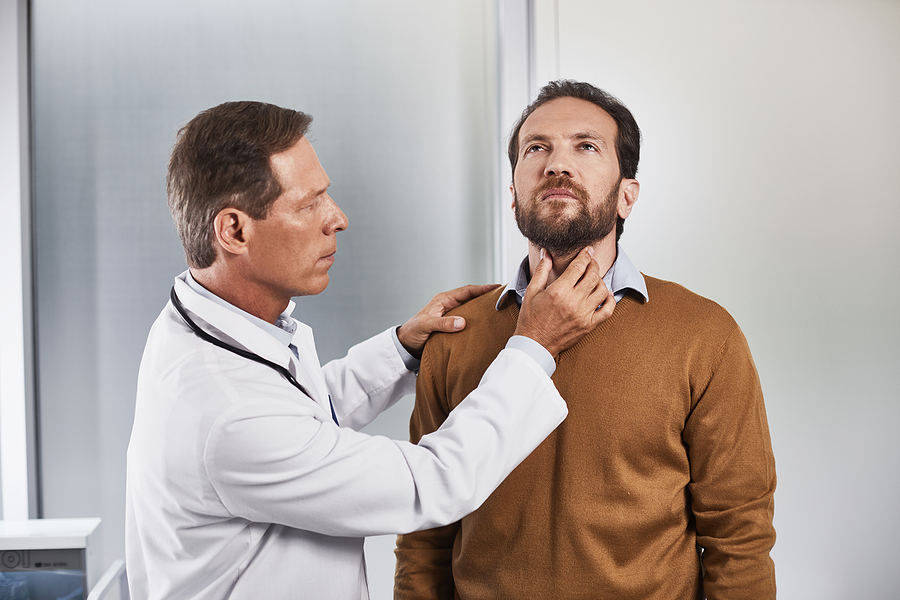 Thyroid surgeon in Melbourne checking a male patient