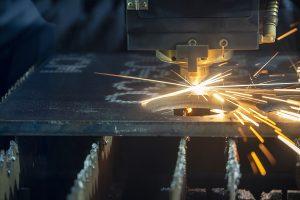 laser cutter cutting a metal plate