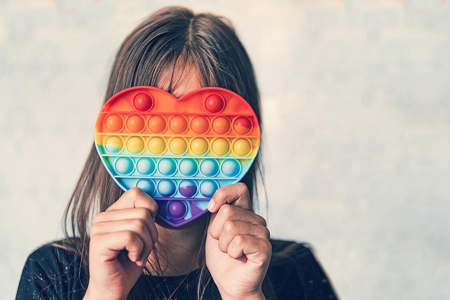 Girl holding a fidget sensory toy in Australia