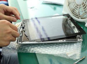 Man repairing in iPad screen